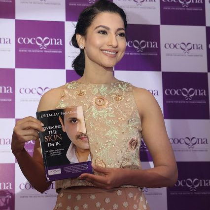 Gauahar Khan with Dr. Sanjay Parashar's book Revealing the Skin I am In-min